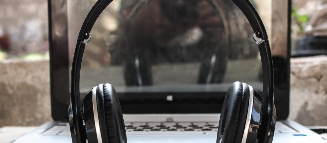 Headphone in front of laptop on a desk